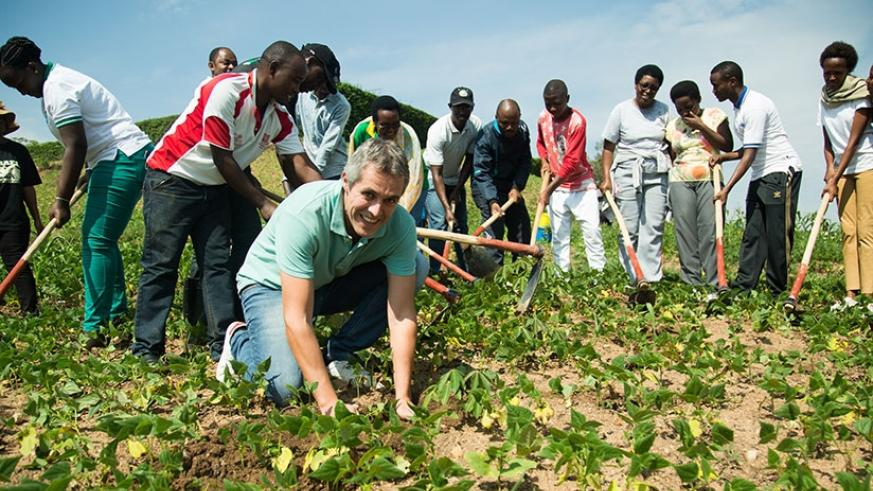 King Faisal Chief Operating Officer Daniel Fernandez Goula and staff of the hospital with residents of Kacyiru sector planting trees around the agricultural marshland of the hospit....