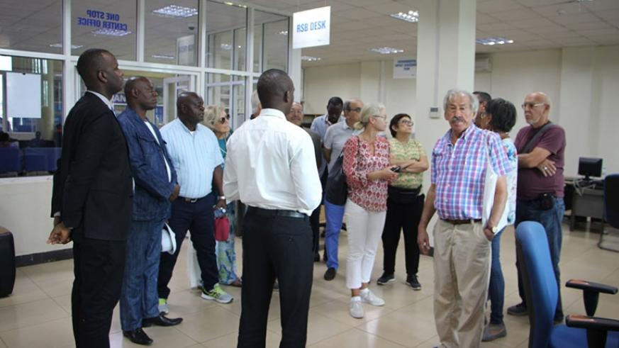 The delegation from Angola tour a one-stop centre at RDB headquarters. / Michel Nkurunziza