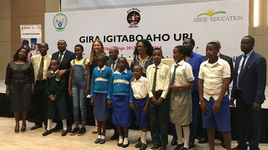 Young Rwandan writers posing for a group photo with various officials during Gira Igitabo Aho Uri campaign launch last week. (Photos by Diane Mushimiyimana)