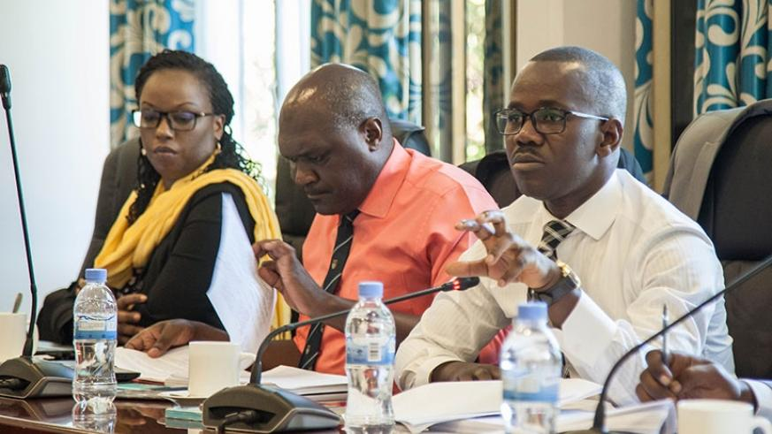 Minister Uwizeyimana (R) addresses lawmakers about the provisions on defamation in the draft Penal Code yesterday. (Nadege Imbabazi)