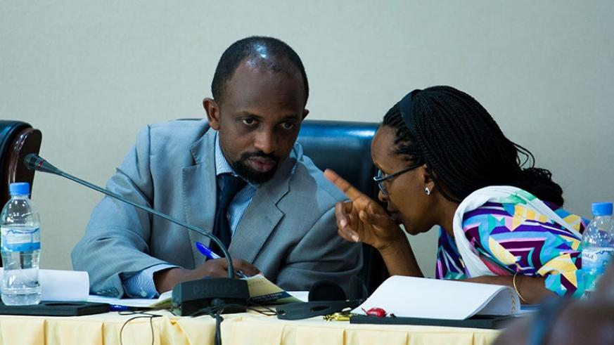 Opirah (L) consults with Bugingo during the meeting in Kigali. (Photos by Timothy Kisambira)
