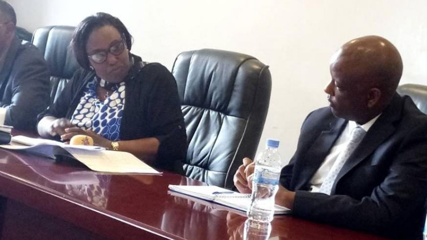 Mark Nkurunziza Chief Financial Officer in RDB, in a discussion with Alphonsine Mukarugema, Vice President of Committee on Social Affairs.