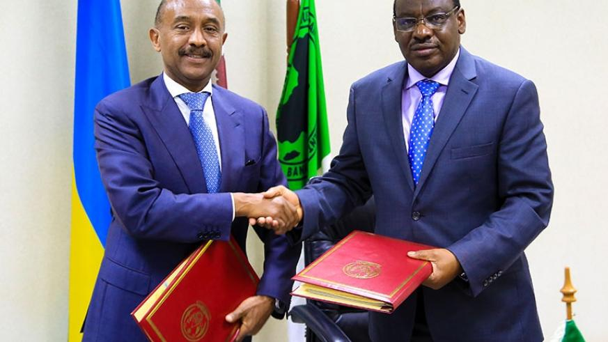 Director General for AfDB in EAC region Gabriel Negatu shakes hands with Minister Claver Gatete yesterday in Kigali. Faustin Niyigena
