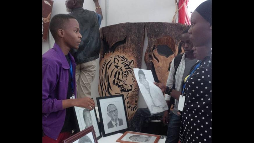 Yannick Mfura, an artist and one of the exhibitors at the ongoing Made-in-Rwanda expo. Mfura of Honore Art Deal draws sketch and portraits using pencils. (Photos by Joan Mbabazi)