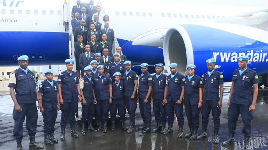 Some of the officers, who returned home from a peacekeeping duty pose with the aircraft crew on arrival at KIA
