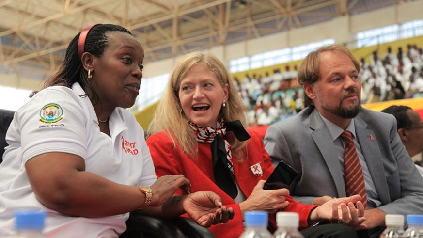 (L-R) Health minister Dr Diane Gashumba chats with US Ambassodor Erica Barks-Ruggles as UNFPA repesentative Mark Bryan looks on during the event to mark World AIDS Day at Amahoro N....
