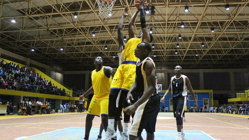 Victoire Mutabaruka of IPRC-Kigali goes to the rim for two points during the  season opener against APR at Amahoro Indoor Stadium on Saturday. Courtesy