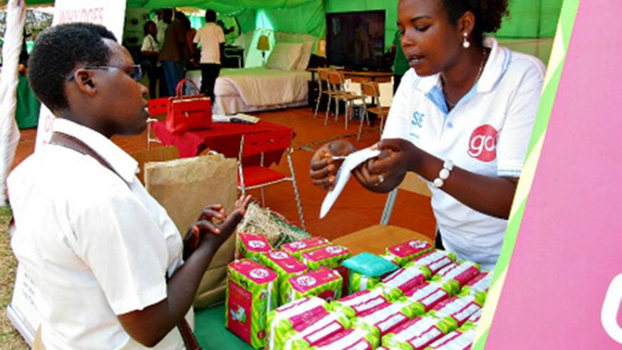 A sales person explains how their locally-made sanitary pads work during a past expo. File