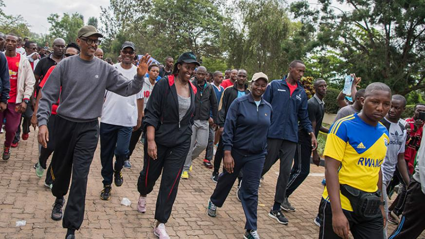President Kagame and First Lady Jeannette Kagame take part in a walk alongside Kigali residents as part of the city's monthly car-free zone day dedicated to pedestrians and cyclist....