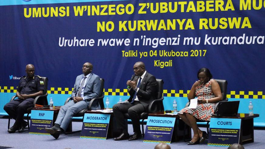 Prosecutor-General Jean-Bosco Mutangana (second right) speaks as the other panelists follow, at the meeting in Kigali yesterday. / Courtesy