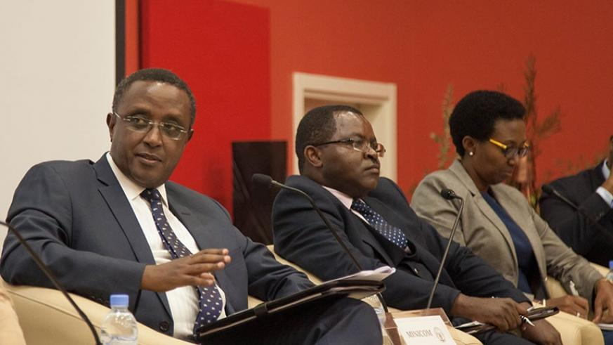 Environment minister Dr Vincent Biruta speaks as Trade and Industry minister Vincent Munyeshyaka (centre) and REMA director-general Coletta Ruhamya look on at the launch of the Gre....