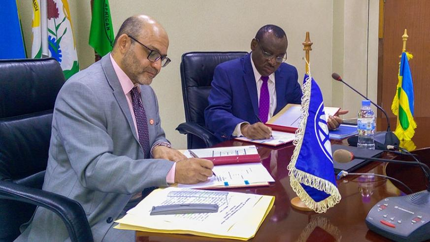 World Bank Country Director Yasser El-Gammal signs the financing agreement ,worth US$125m, with Finance Minister Claver Gatete in Kigali on Monday. / Faustin Niyigena