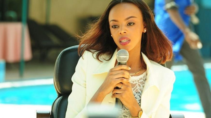 Former Miss Rwanda, Jolly Mutesi addresses the youth at a past forum in Kigali. Net.