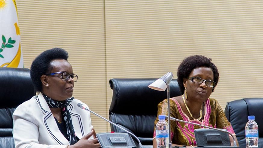 Senator Marie Claire Mukasine (L), the president of African Parliamentarians Network Against Corruption (APNAC) Rwanda Chapter, speaks as as MP Veneranda Nyirahirwa looks on yester....
