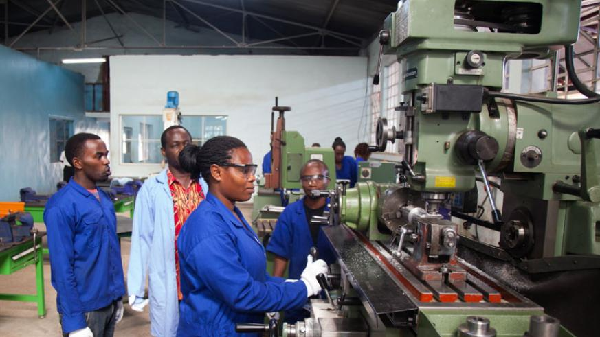 Marie Mukahirwa, a student at IPRC Kigali operates a machine in one of the workshops at Kicukiro campus.