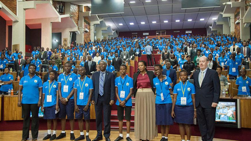 Prime Minister Dr. Edouard Ngirente and Gender and Family Promotion minister Esperance Nyirasafari, poses for a photo with all the children that attended the summit. / Nadege Imbabazi