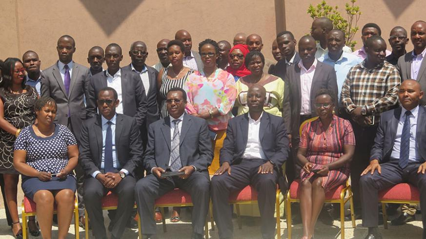 Customs agents and stakeholders pose for a group photo after the workshop. Eddie Nsabimana