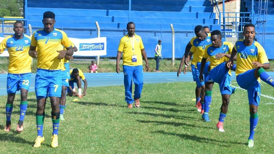 Amavubi players warming up before Thursday's game against Libya, which ended 0-0. Rwanda will face Tanzania today in their last game in the tournament. Courtesy.