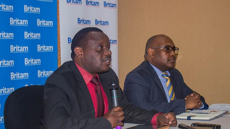 Uwamungu (left) explains how the new medical insurance product works during the launch event. Right is Dennis Koori, the health department manager at Britam Rwanda. / Courtesy