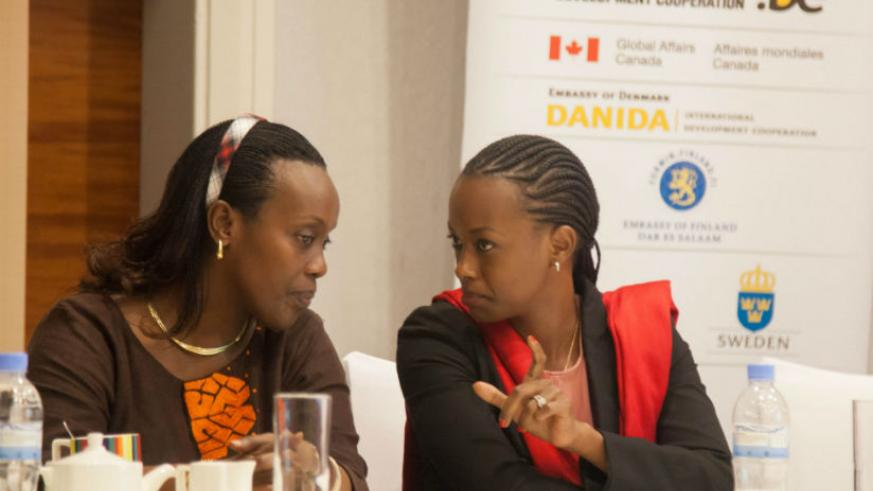 Minister of Health Dr. Diane Gashumba chats with Country director for Trade Mark East Africa Patience Mutesi during the launch of the pharmaceutical regulatory services offered by ....