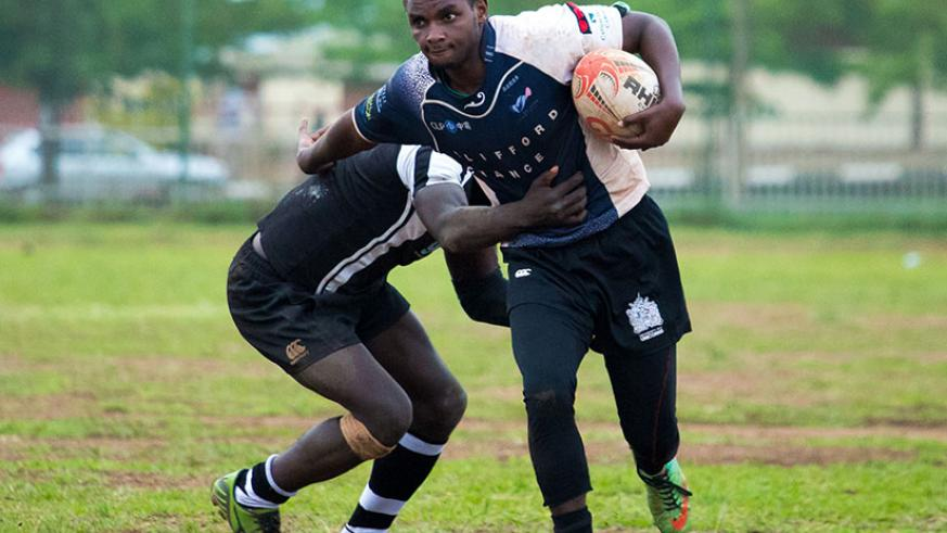 Heritier Habimana of 1000 Hills shrugs off challenge from a Resilience  player during the final game over the weekend. / T Kisambira