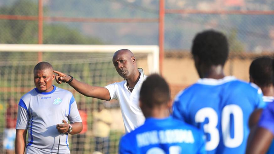 Karekezi gives instructions to his players at Nzove ground on his first day back to work after his release from police custody about a week ago. / Sam Ngendahimana