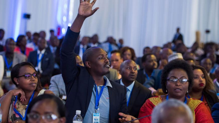 A participant seeks to ask a question during last year's Umushyikirano. / File