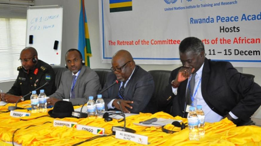 L-R: Director of the RPA, Col Jill Rutaremara; Phillip Karenzi, First Counselor, Rwanda Embassy in Ethiopia; Blaise Edouard Gouende, Chairperson of the Committee of Experts of the ....