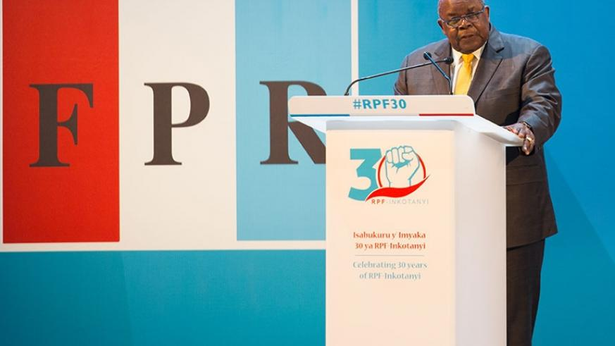 Mkapa delivers his keynote address at the international conference organised by the RPF-Inkotanyi in Kigali yesterday. (Photos by Timothy Kisambira)