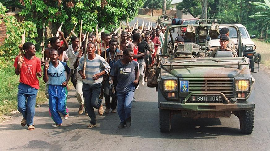 French soldiers, seen in this undated picture with members of the Interahamwe - the pro-government militia that carried out most of the killings - are accused of supporting the gen....