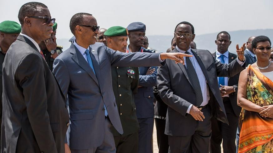 President Paul Kagame, flanked by senior political and military figures, gestures at Parliament in Kimihurura, where he inaugurated the Campaign Against Genocide Museum, yesterday.....