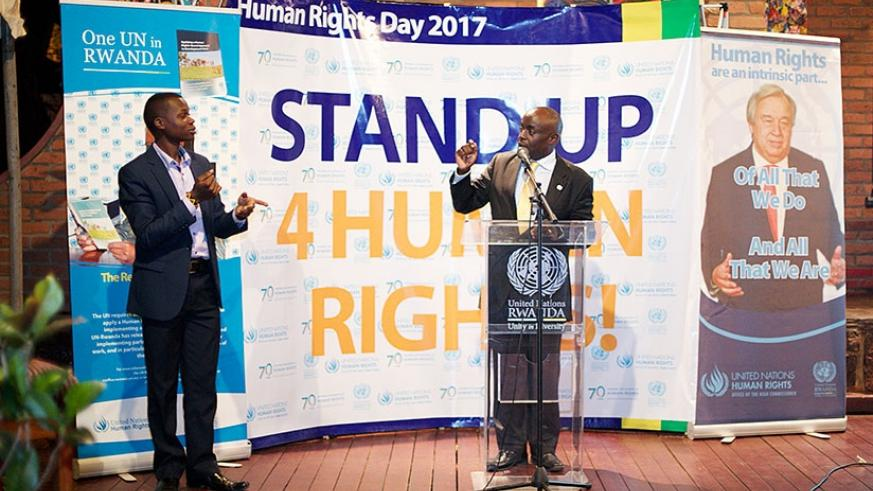 Chris Mburu, senior human rights advisor, United Nations Office of the High Commissioner for Human Rights, gestures to a participant at the event in Kigali. Courtesy.
