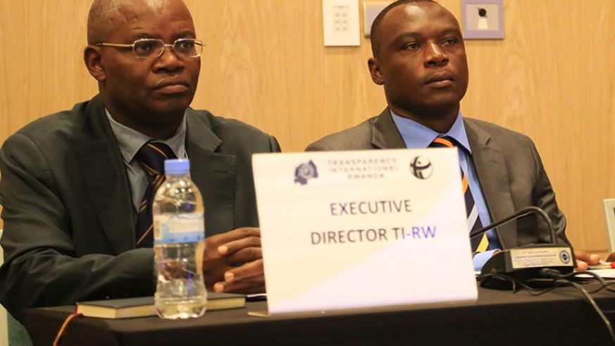 L-R: Appolinaire Mupinganyi, the Executive Director TIR, and Clement Musangabatware, Deputy Ombudsman, follow the presentation during the meeting. Sam Ngendahimana.