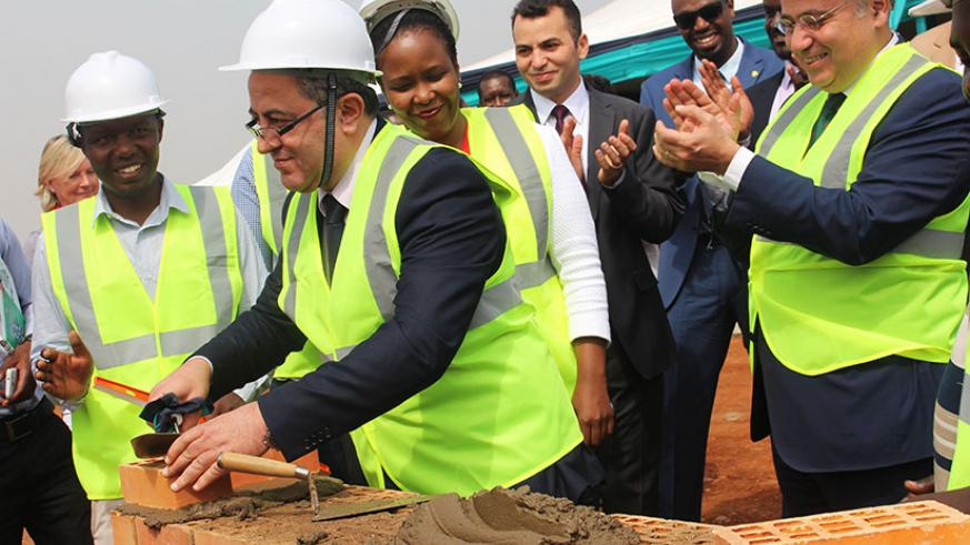 Amb.Youssef Imani and other officials lay a foundation stone at the Special Economic Zone in Kigali yesterday. Sam Ngendahimana.
