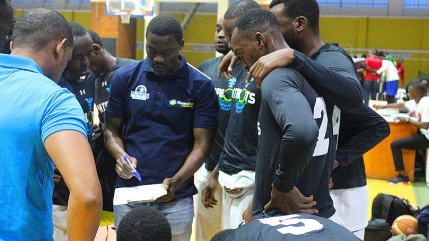 Patriots head coach Henry Mwinuke (centre) briefing players during last Saturday in a game against Espoir. / Courtesy