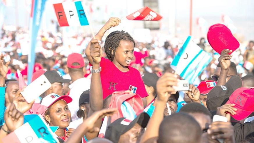 A young supporter of  the RPF Inkotanyi at a campaign event in Gasabo District. The RPF today is laying ground work to guarantee a better future for generations to come. Village Urugwiro.