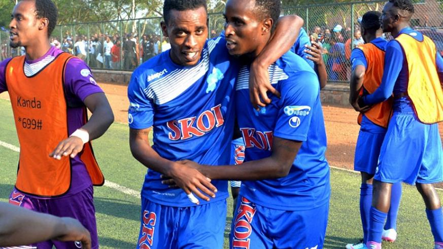 Goal scorer Eric Irambona, right, celebrates with teammate Eric Rutanga at the end of the match between Rayon Sports and Police FC at Kicukiro Stadium. Courtesy.