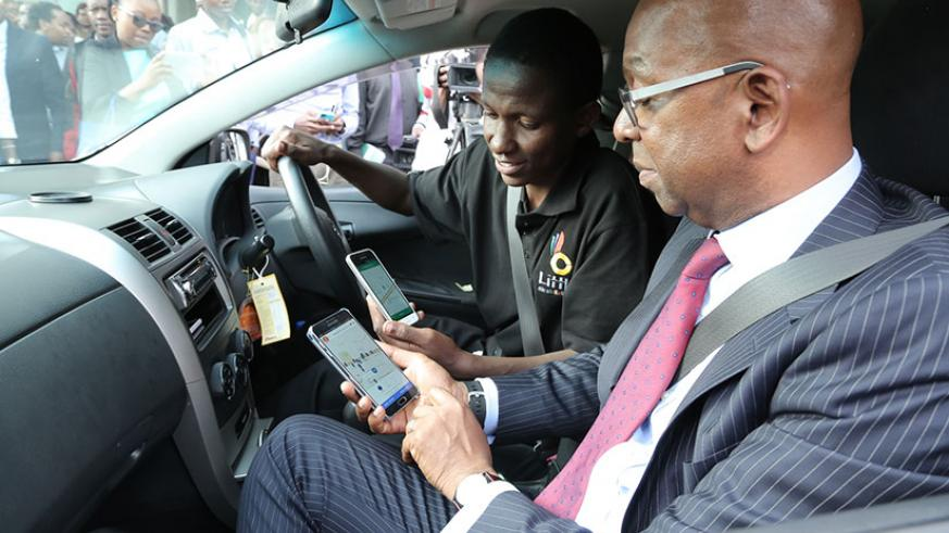 Safaricom CEO Bob Collymore during the launch of the telco's first ride-hailing app 'Little Cab' in Nairobi last year. / Net photo