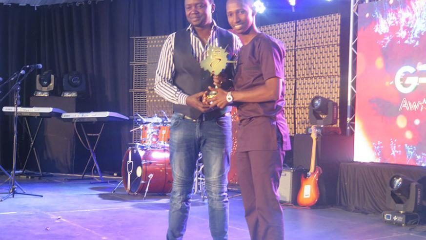 Gospel artiste Israel Mbonyi (R) receives his award on Sunday. / All pictures by Eddie Nsabimana