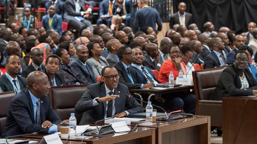 President Kagame speaks during deliberations at the National Dialogue Council (Umushyikirano) at Kigali Convention Centre yesterday. Looking on, left, is Primier Dr Edouard Ngirent....