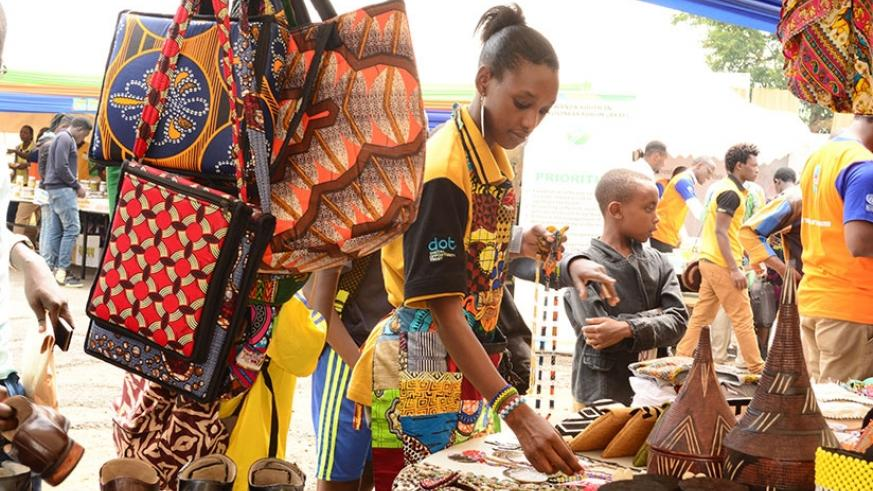 An exhibitor arranges her products at the exhibition on Monday.  / Frederic Byumvuhore.