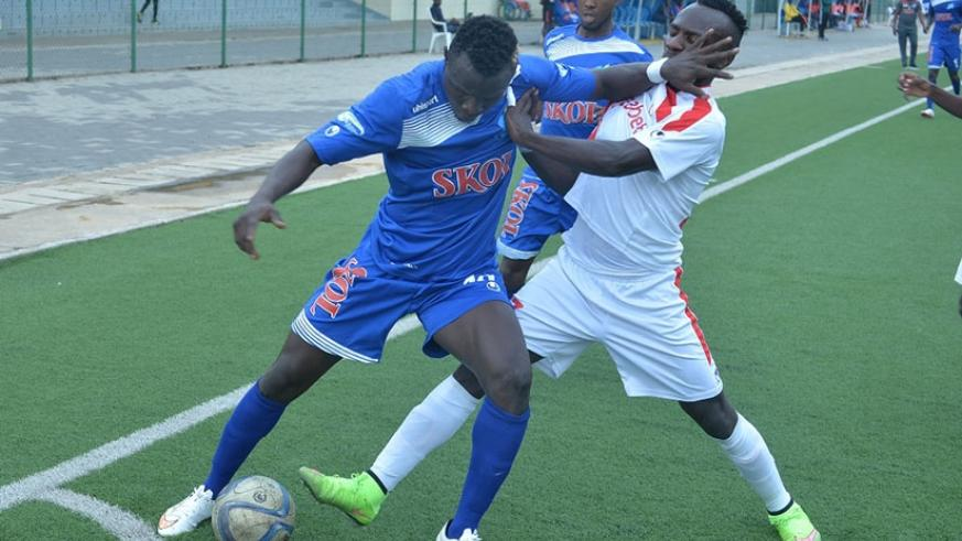 Rayon Sports' Malian striker Tidiane Kone battles with Etincelles' players during the league match on Wednesday, which the Blues lost 1-0. Courtesy