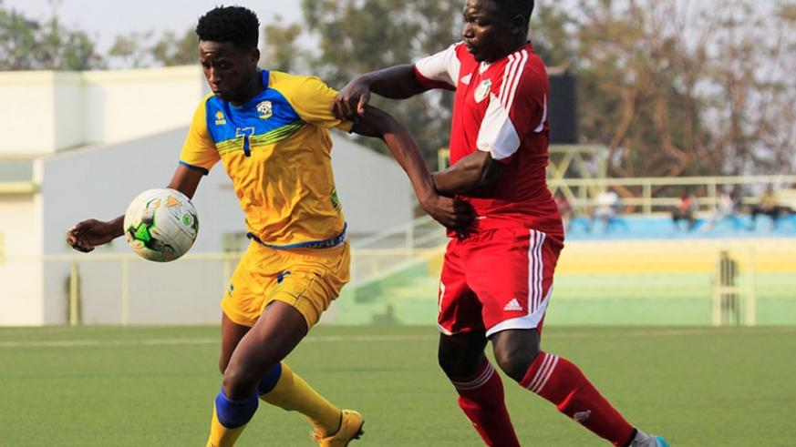 Amavubi forward Christophe 'Abeddy' Biramahire shields the ball against a Sudanese defender during a friendly match played on August 8 in Kigali. S. Ngendahimana.