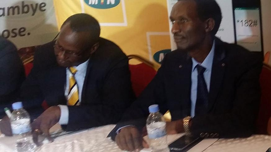 Rutagengwa (left) and Amasezerano Bank  MD at the deal signing event. /  Peterson Tumwebaze.