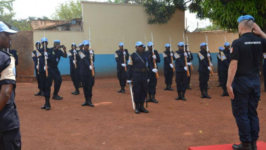 MINUSCA Police Commissioner inspecting a Guard of Honor mounted by Rwandan peacekeepers, on arrival at their base camp. / Courtesy