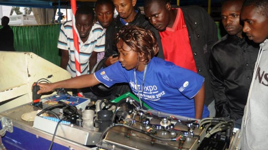 A student of mechanics explains how an engine works during a TVET expo in Kigali. (File)