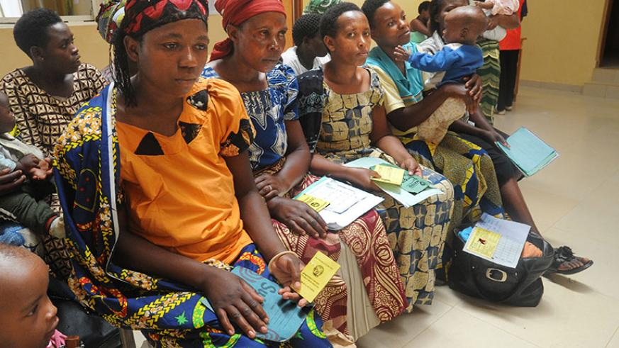 Mothers hold their insurance cards at Gashora health centre. (File)