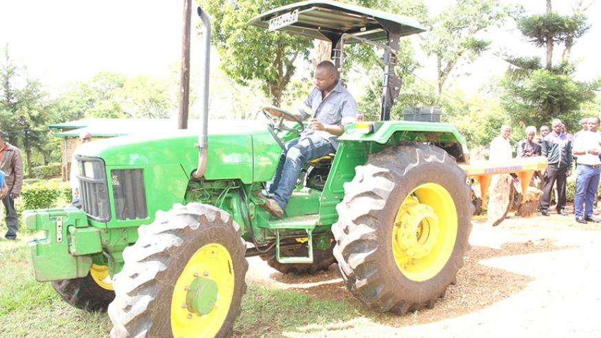 One of the tractors the University uses at its farm in Ngoma District. Minister Nsengiyumva visited UNIK as part of efforts geared at finding solutions to challenges that farmers f....