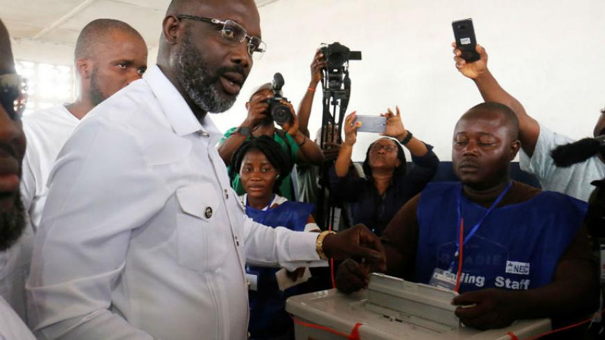 Former football star George Weah votes in Liberia's election. / Internet photo