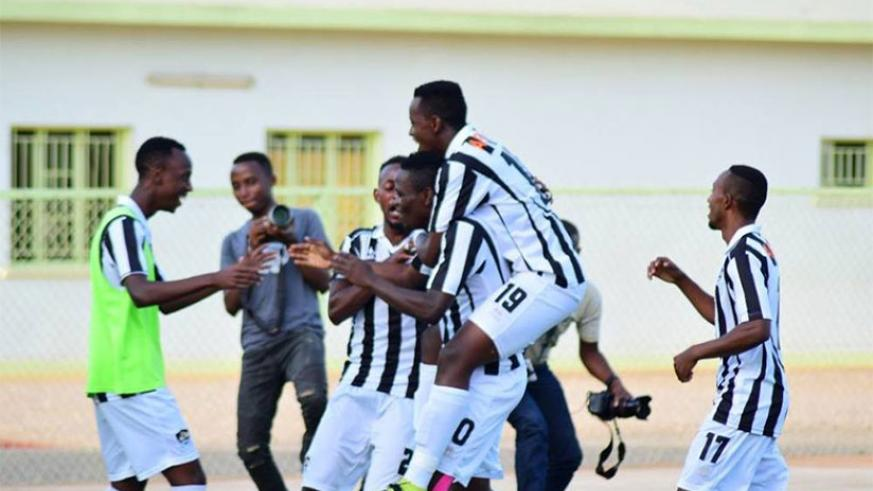 Muhadjir Hakizimana is mobbed by APR teammates after scoring against Musanze FC in a match that ended 1-1 on Wednesday at Kigali Stadium.  Courtesy